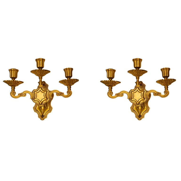 Pair of Caldwell Gilt Metal Three-Light Sconces