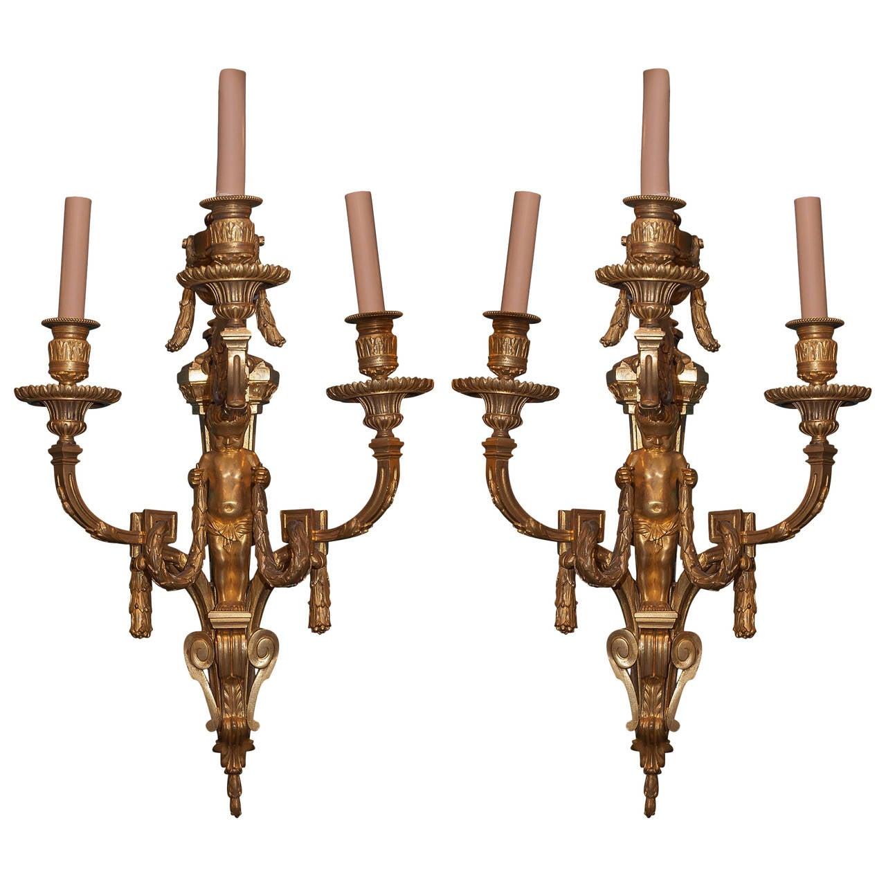 Pair of Gilt Bronze Fgural Louis XVI Style Three-Arm Wall Light Sconces