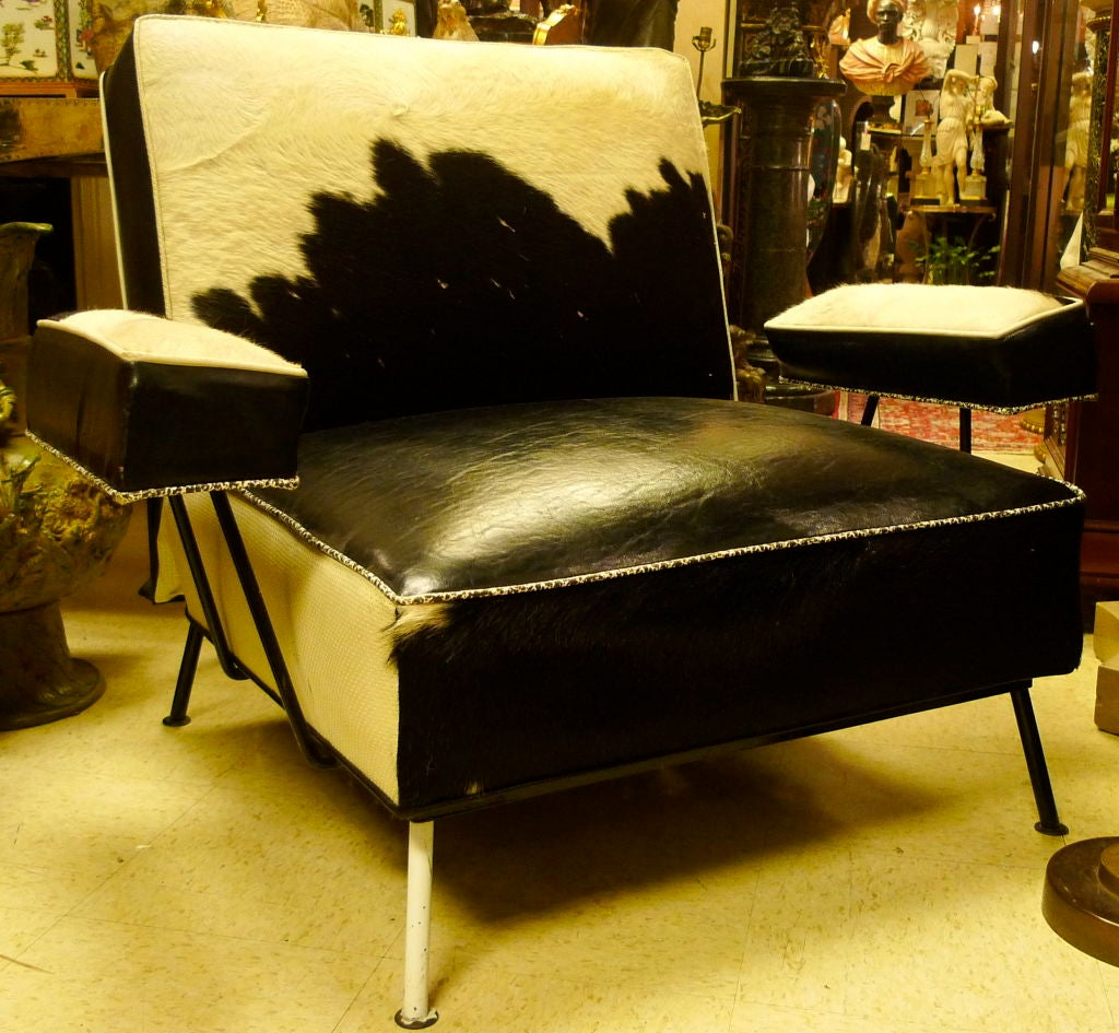 cowhide and leather mid century armchair and ottoman at