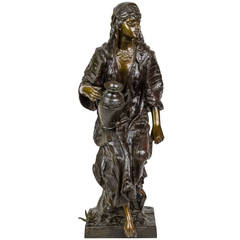 Signed Orientalist Bronze Figure of a Gypsy Seated on Rocks Holding Water Jug