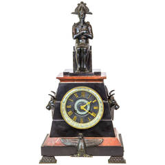 Egyptian Revival Patinated Bronze and Rouge Marble Figural Mantel Clock