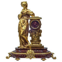 Gilt Bronze and Rouge Marble Figural Table Mantel Clock