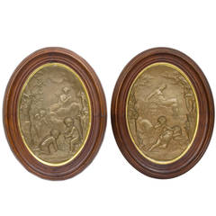 Pair of Oval Patinated Metal Wall Plaques with Cherub Decorations