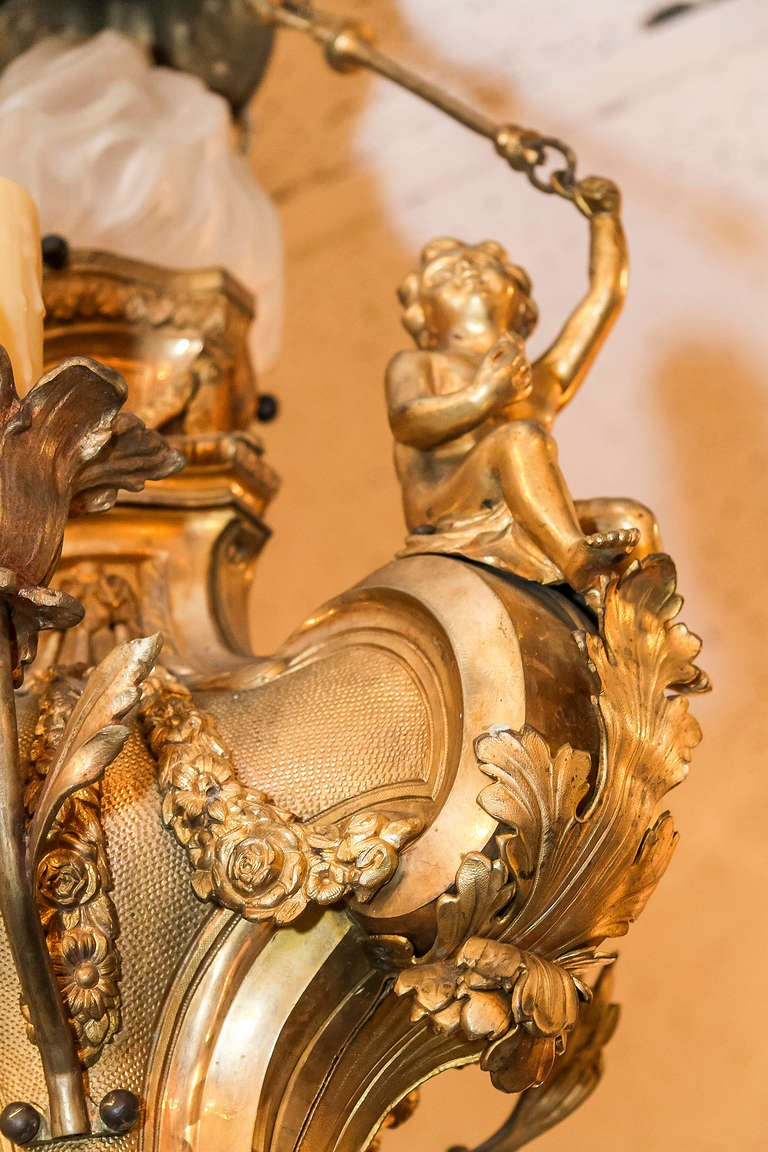 A Louis XV Style Gilt Bronze Figural 4 Light Cherub Chandelier with Seated  Cherubs Stock Number - A Louis XV Style Gilt Bronze Figural 4 Light Cherub Chandelier At