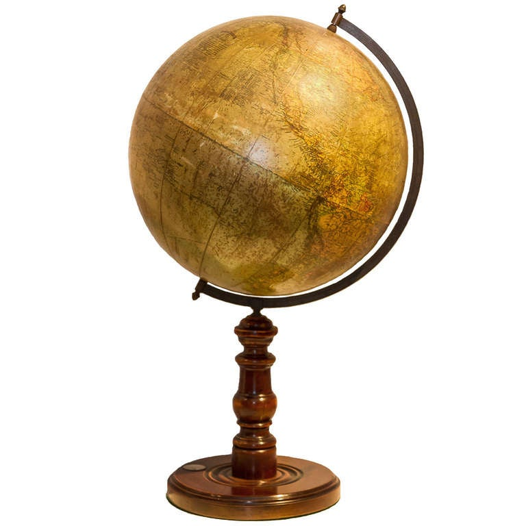 A desk globe on wooden base with compass 1