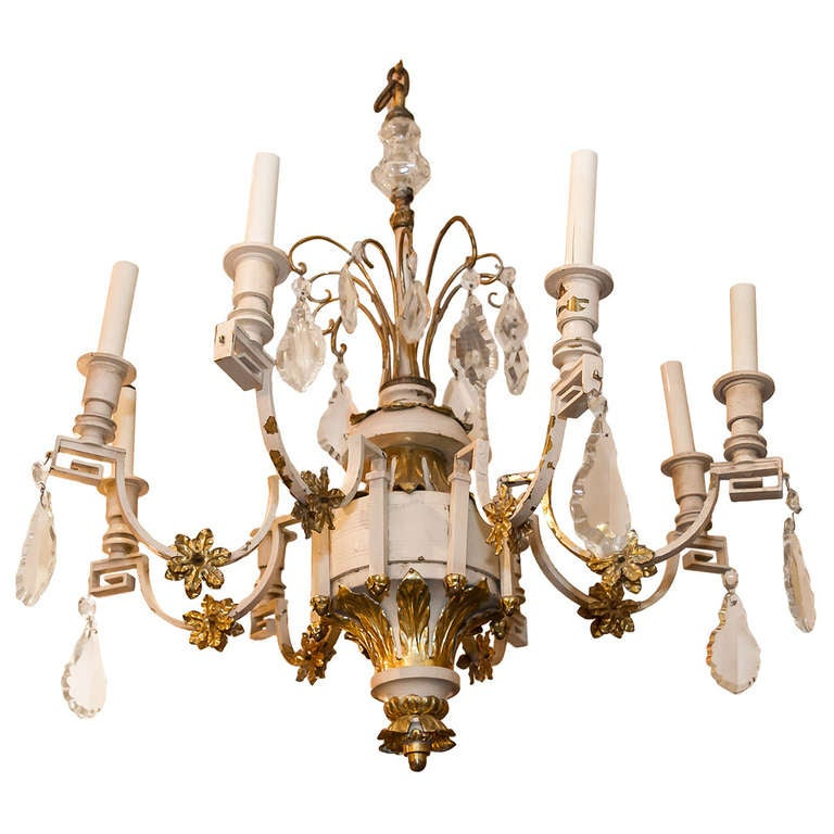 A Rustic Painted Metal and Gilt 8 Arm Chandelier