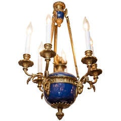 A Louis XVI Style Six Light Chandelier with Rams Head