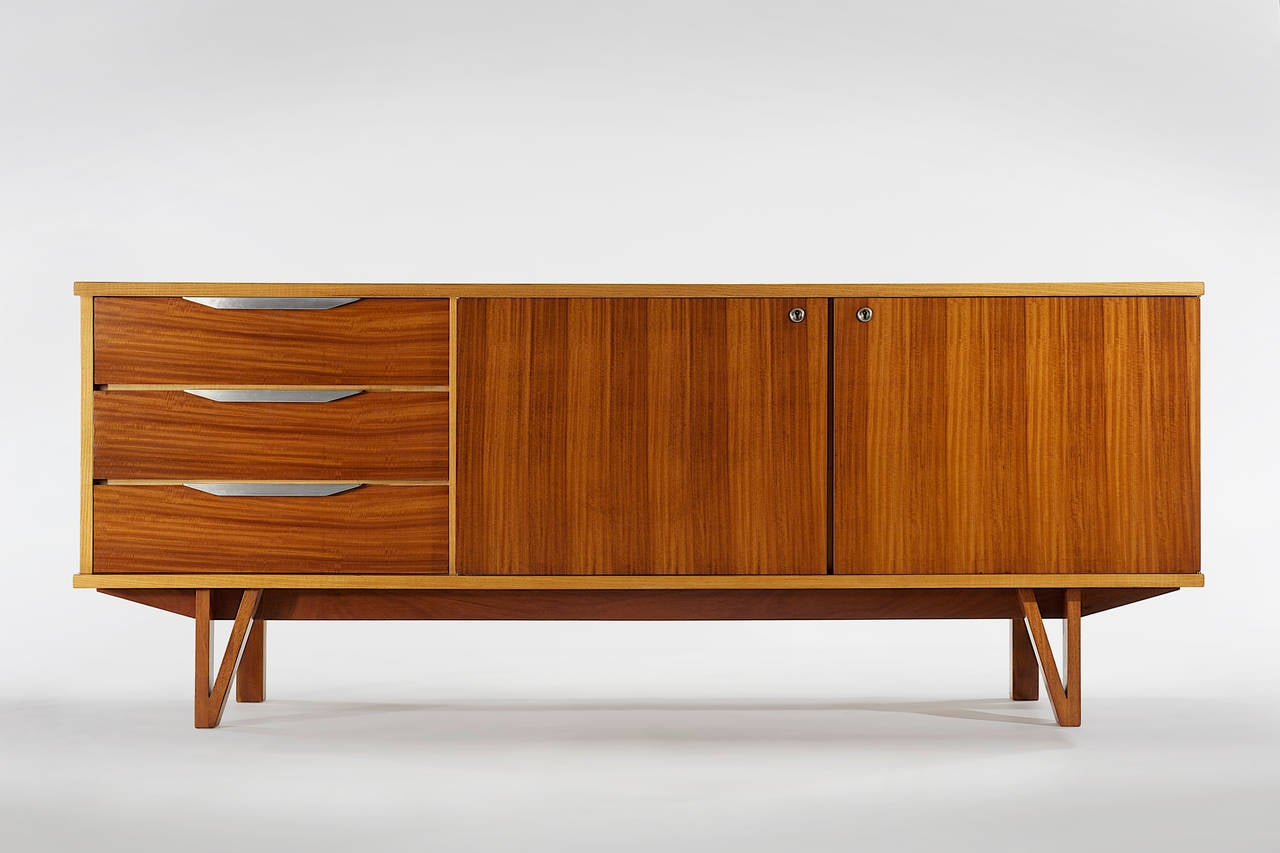 Credenza by René Jean Caillette in frêne (ash) and mahogany with aluminum handles.  Designed in 1957 and manufactured by S.A.D.E.A.  ABOUT THE DESIGNER: René-Jean Caillette (1919–2004), was the son of a woodworker. He always intended to follow