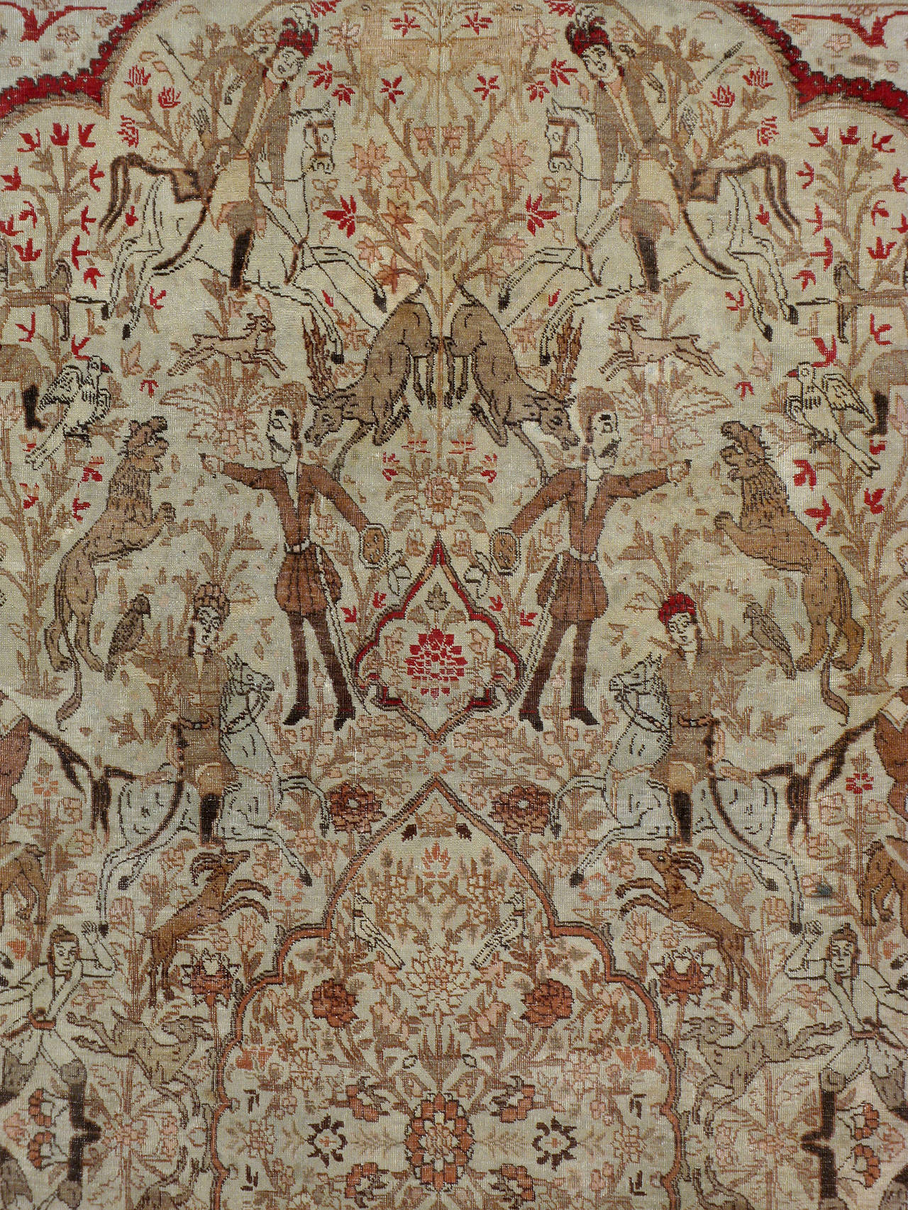 An antique Persian Tabriz carpet from the turn of the 20th century depicting a pictorial design of a Persian hunting ground.   Antique and vintage animal rugs are desired for both its decorative appeal and character because of the great