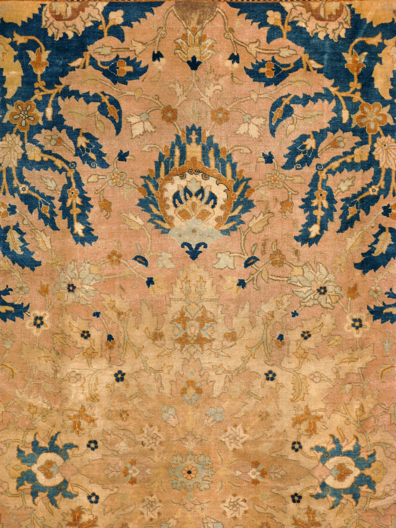 A Persian Tabriz carpet from the first quarter of the 20th century. Since the 19th century, Iran started exporting artisan carpets around the world, especially to Europe. Artists used one of the three versions of vertical looms later referred to as