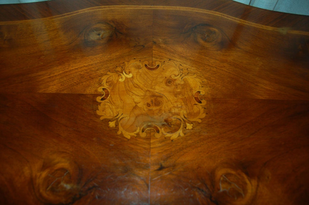 Female Biedermeier table and chair set.
