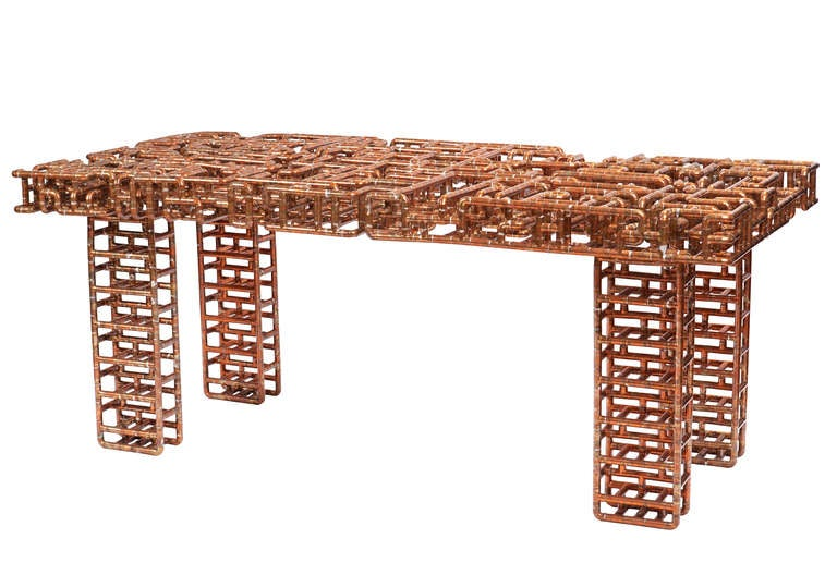"""Title: Sangre y Tanqueray Year: 2010  An outstanding dining table or executive-style desk constructed entirely of 1/2"""" copper tubing, featuring geometrically constructed legs that support a chaotically-woven surface finished with a"""