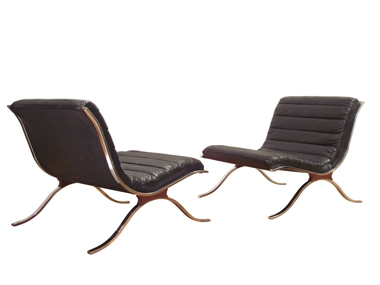 pair of channel tufted chairs in chrome after arne norell 2 channel tufted furniture