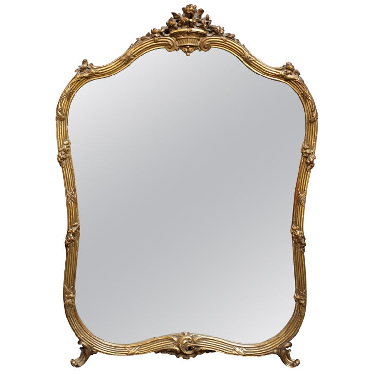 Gilt mirror with scroll and ribbon design at 1stdibs for What is a gilt mirror