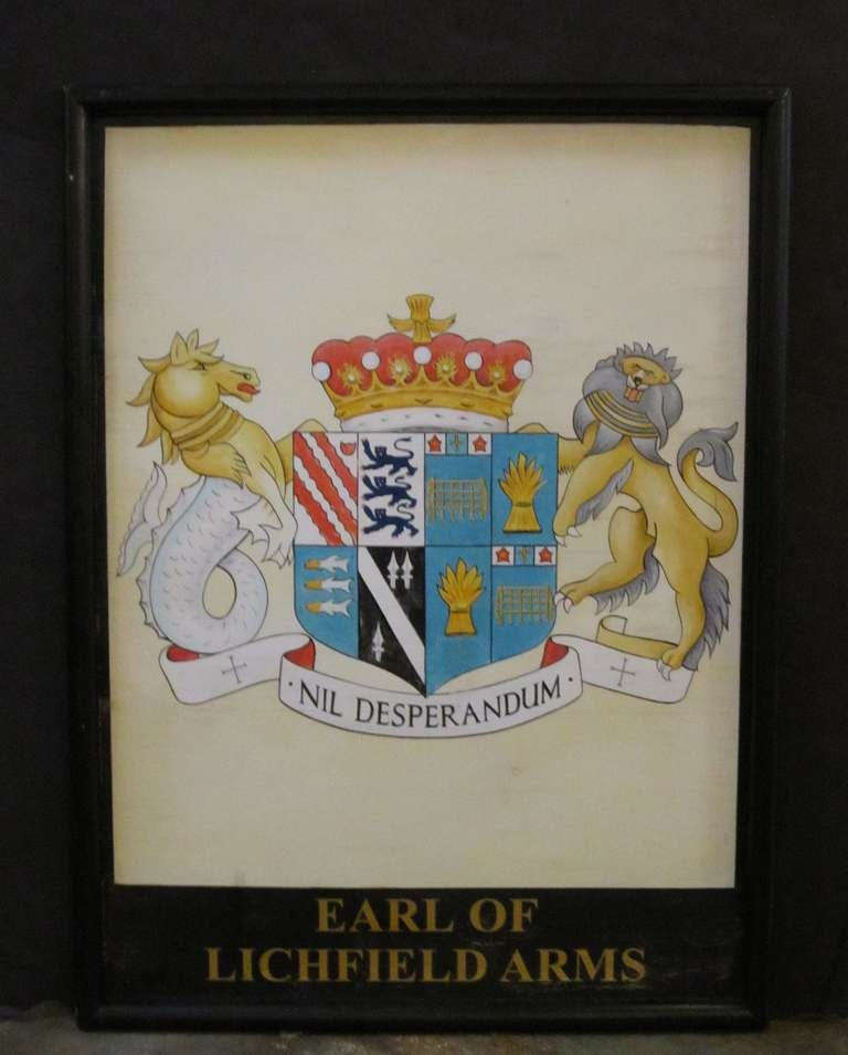 An authentic English pub sign (one-sided) featuring a painting of the heraldic arms of the Earl of Lichfield, entitled: Earl of Lichfield Arms.  A very fine example of vintage advertising artwork, ready for display.
