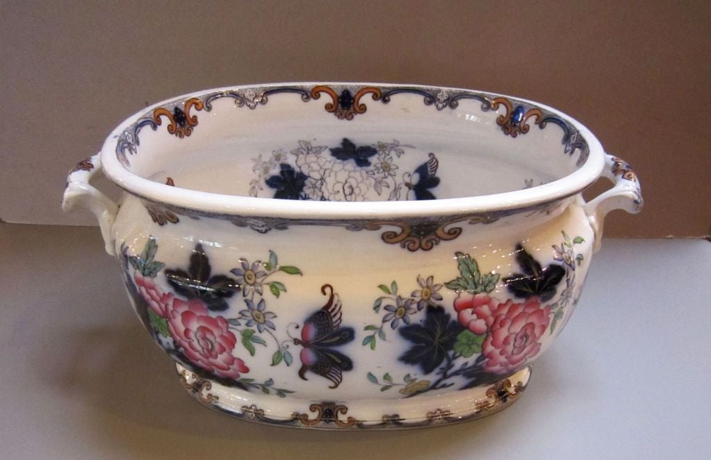 A beautiful ironstone footbath in the Poonah pattern by the celebrated English pottery firm, Charles Meigh, circa 1835-1849, featuring a polychrome design of flowers and butterflies on the exterior and interior. Perfect as a centerpiece display or