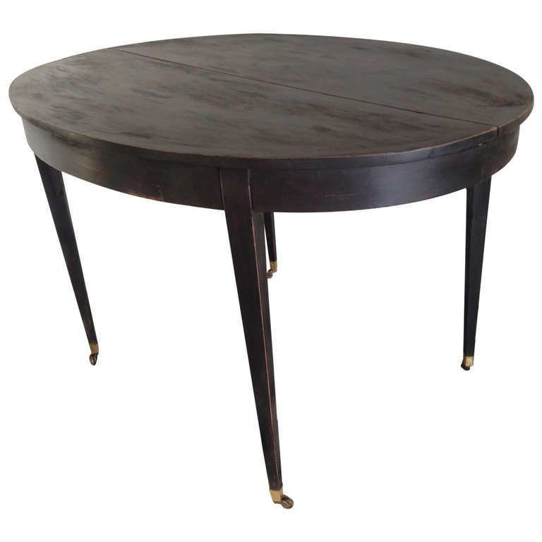 this swedish gustavian dining table on brass casters is no longer