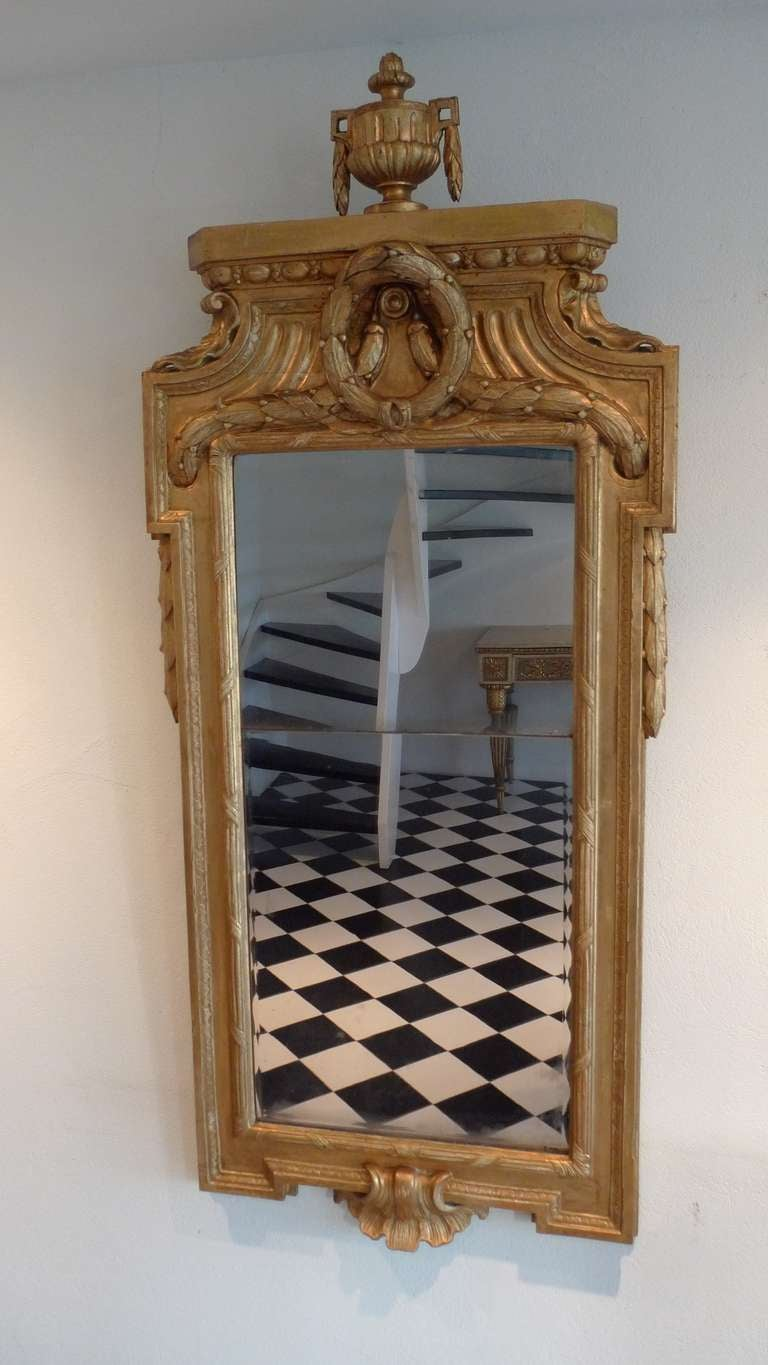 Giltwood mirror made in the transition between the high Gustavian and Late Gustavian period, 1780. The mirror is not signed but attributed to the greatest mirror maker in Sweden during the Gustavian Period (1751-1799). A very similar mirror was made