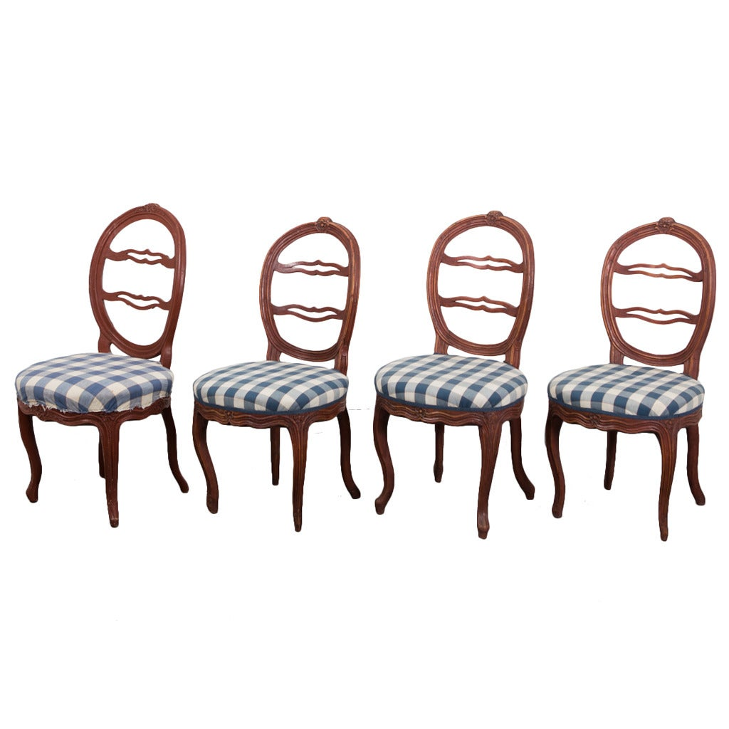 "A Set of Four Side Chairs ""Laughing Chair"""