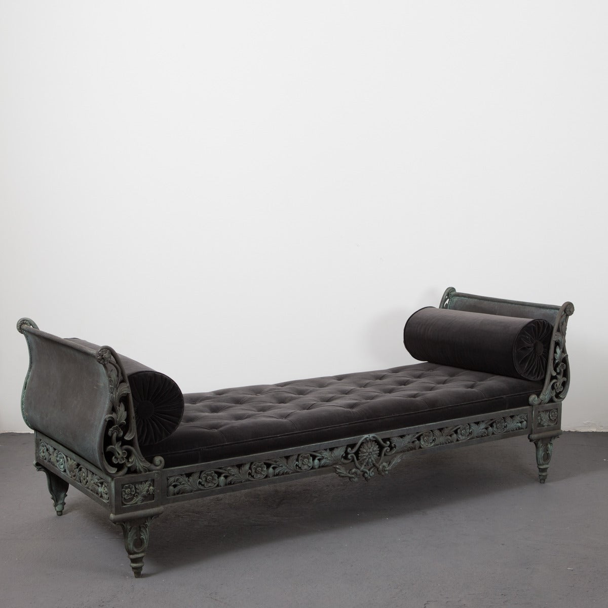 Daybed French 20th Century Cast Iron France. A cast iron daybed in a oxidized green color. All in cast iron with cushion and bolster in dark gray velvet. Frame decorated with flowers and leaves, would go perfectly on a porch or in a garden. Made