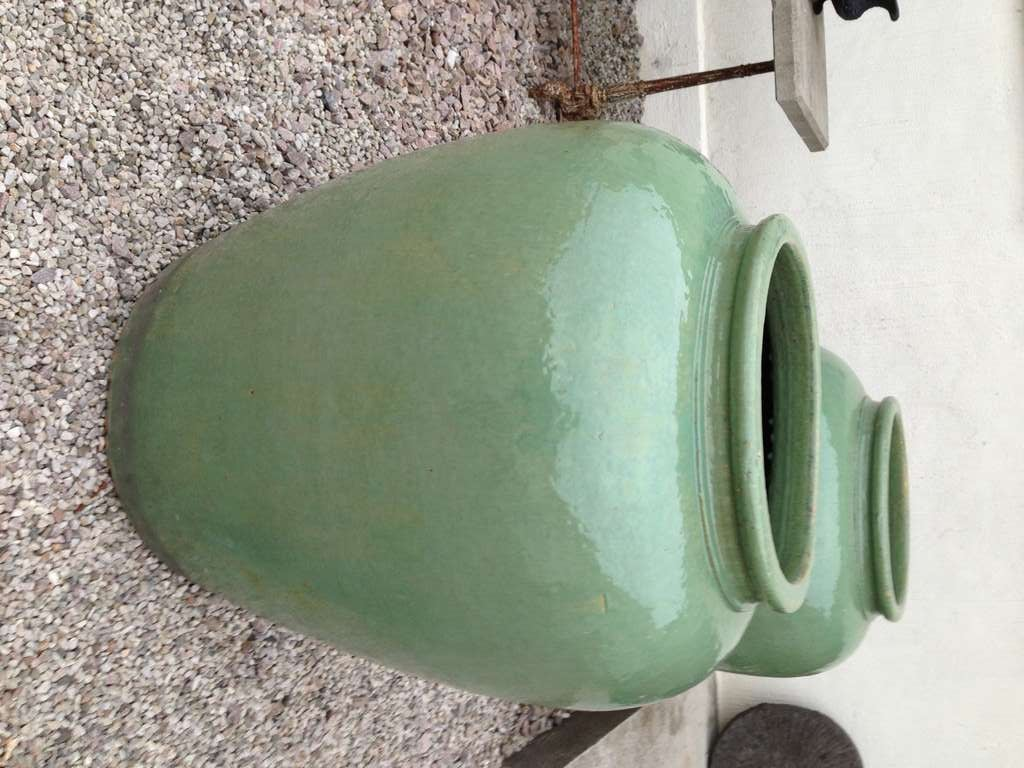 A pair of gorgeous urns in a very large size. Celadon ceramic glazed pottery in a deep mint green. This item is arriving with our new shipment ETA 15th of September