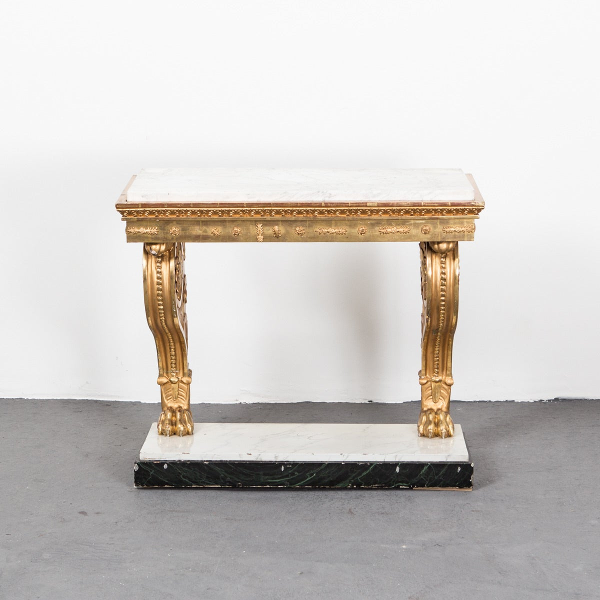 Table Console Swedish Gilded Carrara Marble Top Empire Neoclassical Sweden. A Karl Johan console table made during the Karl Johan period, circa 1810 in Sweden. Gilded wood with carvings typical for the period. Legs ending with lions feet. Top made