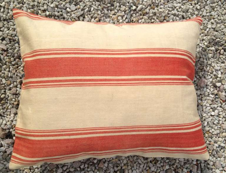 A Pair of Pillows Made from Swedish 19th century Fabric. Red and white stripes.