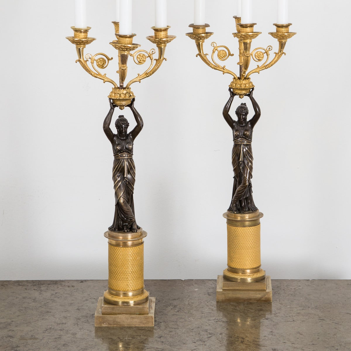 A pair of French candelabras in giltbronze and dark patinated bronze. Beautiful quality and patina.