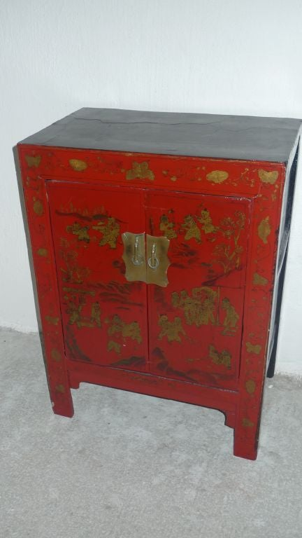 A Chinese red lacquered nightstand with
