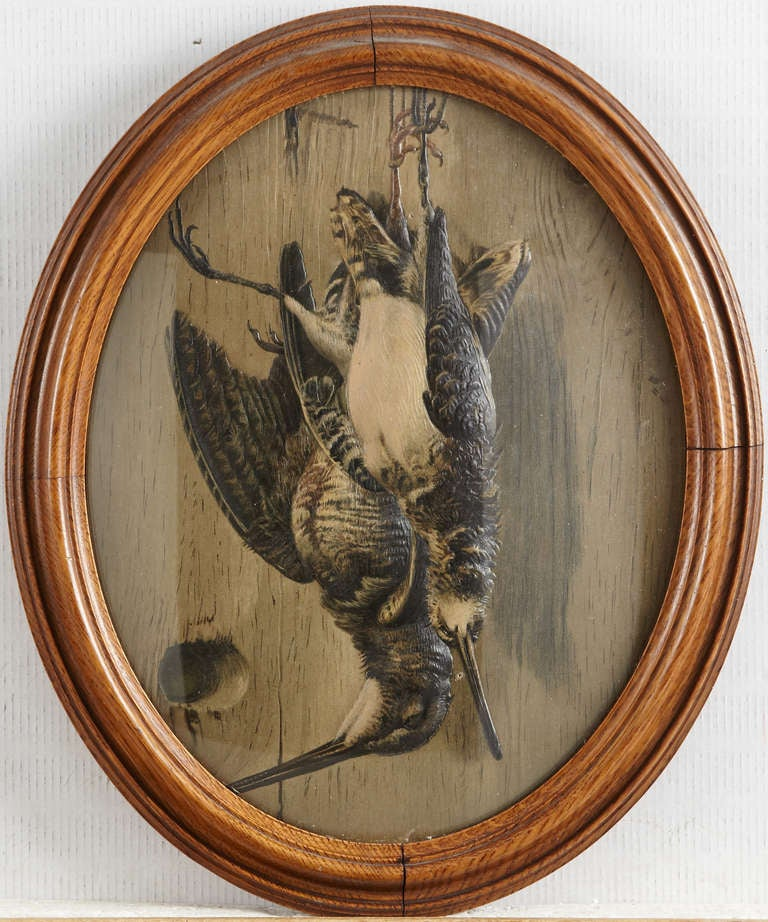 A set of 5 paintings with hunting themed motives. Framed in mahogany frames. Made early 20th Century.