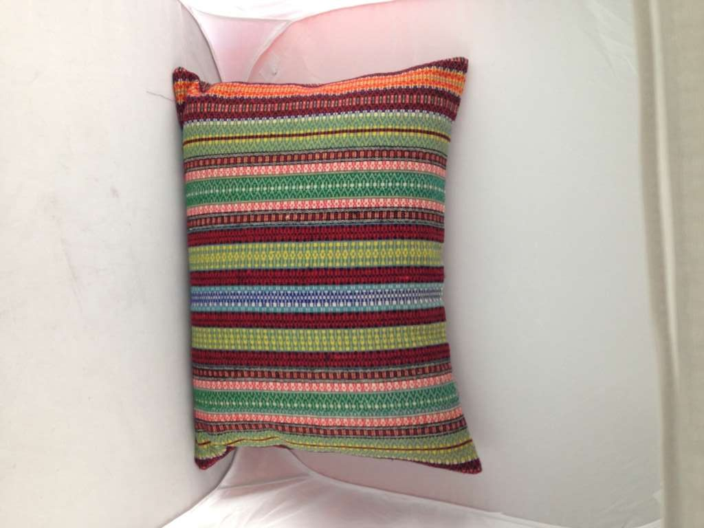 A pillow made from 19th Century textile. Cover made with zipper.