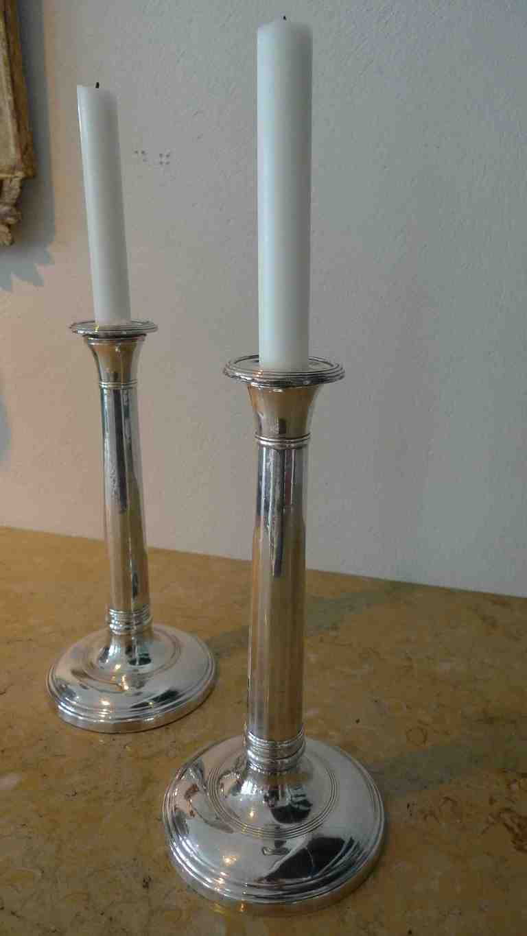A pair of English candlesticks made in plate from the 19th Century.