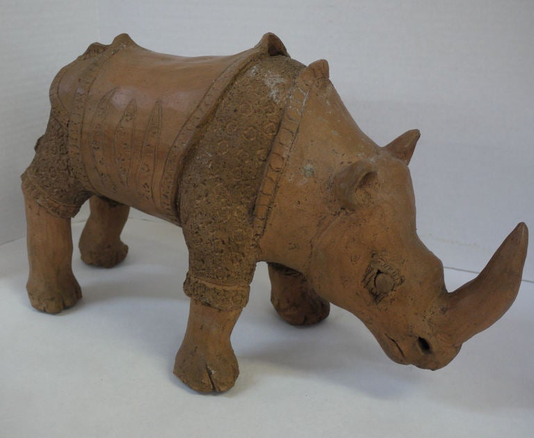 Large vintage Studio pottery rhino from the 1950's, great texture and patina on the rhino.  All constructed hollow but still heavy, weight and texture seems like the material they make bricks out of.  Heavy and aged looking.