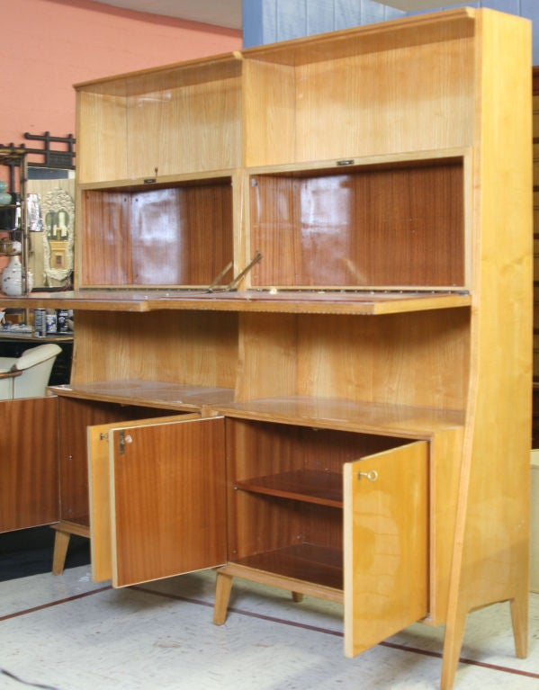 Stunning bookcase or wall unit in the style of Gio Ponti. Constructed of lacquered fruitwood and an ingenious modular design.  I have matching desk which came from the same place.