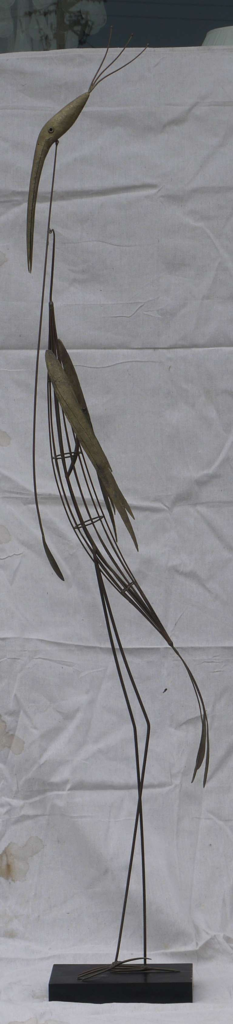 Wonderful kinetic melt coated brass sculpture of a crane with articulated head, wings, and neck which moves gently and was made by New York artist Ruddolph Turnbull, circa 1950.