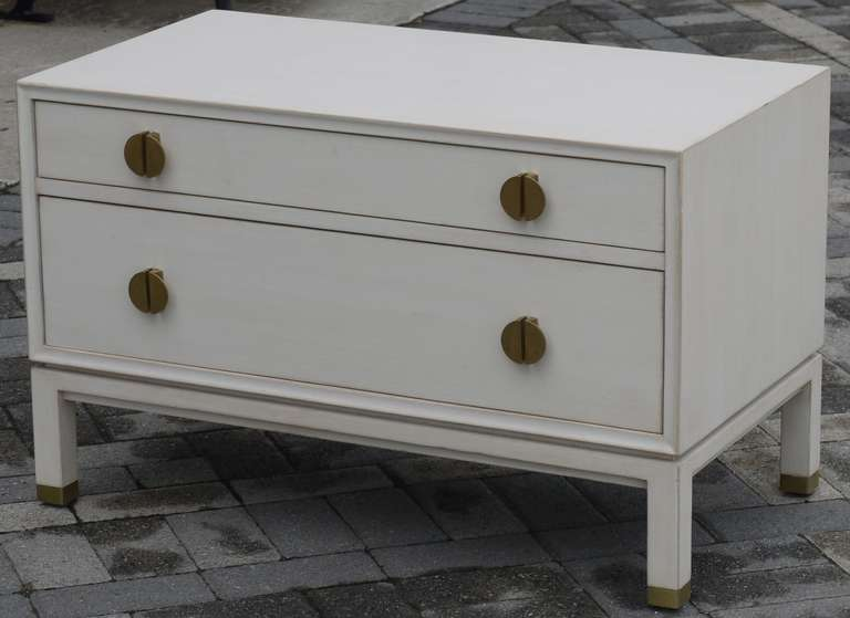 Wonderful custom Dunbar chest designed by Edward Wormley redone in a faux ivoy finish.  Great scale which could easily be used behind a sofa or under a window.