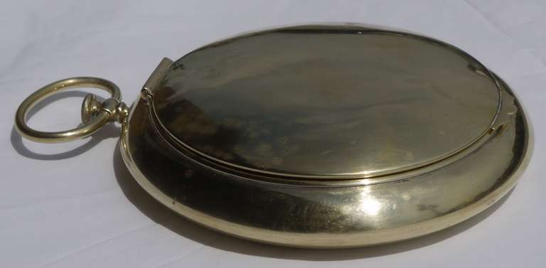 Stunning brass pocketwatch shaped hinged box constructed using brass.  Interior of box is lined in brass as well, and stamped