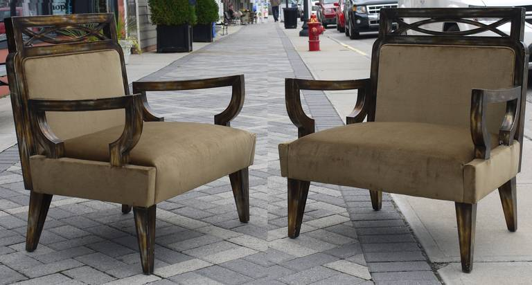Stunning pair of 1950's pair of camouflage gilded chairs with a rubber lacquer faux finish designed by James Mont in the 1950s.   Love the expressive stance these chairs have.  They have been recently reupholstered in a dark antique gold toned