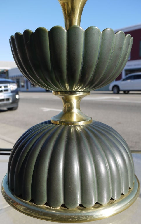 Rare pair of Japanese inspired lamps by Gerald Thurston for Lightolier designed in the 1950s.  Subtle gray green color which is reminescent of unripe gourds.  Unusual to have the Original finials still intact