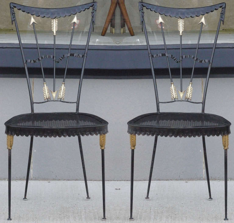 Wonderful pair of Italian iron chairs with brass appointments by Tomaso Buzzi, circa 1940.