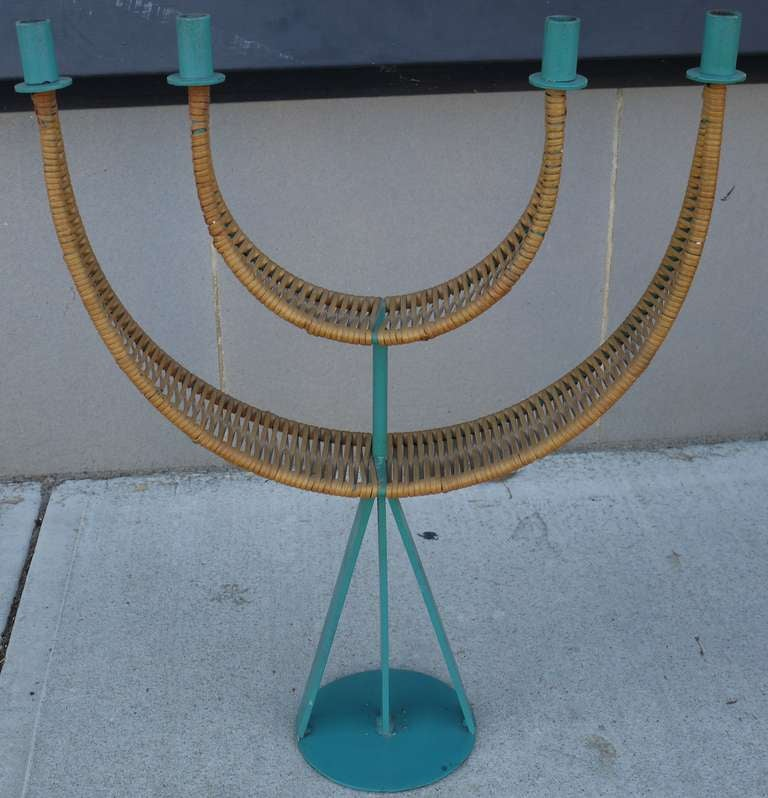 Large sculptural candelabrum in original enamel teal and cane by Arthur Umanoff.   Teal is original to piece and is rarer than the black.  Also have the same candelabra available with black enamel.