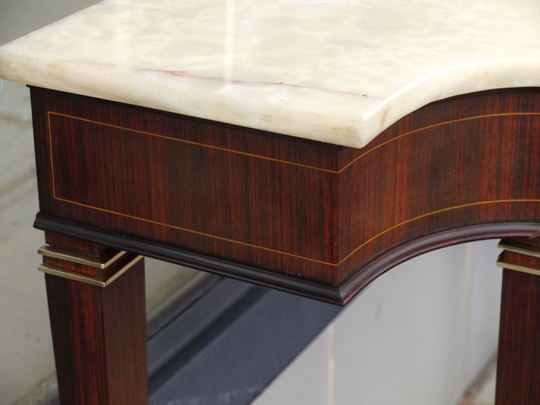 A Rosewood and Onyx console table by Paolo Buffa with boxwood pinstripe greek key detail and polished brass details.