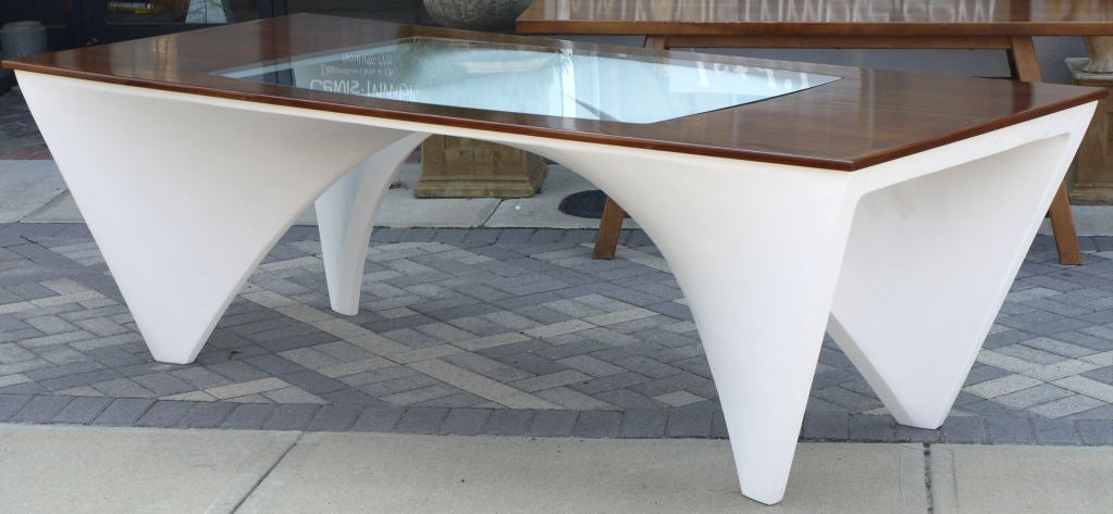 Stunning handmade architectural dining table constructed with a wood frame covered in fiberglass, with a starburst rosewood top with an inset glass top to reveal the dynamic structure. Could be used as a desk, dining table, or for a stunning display
