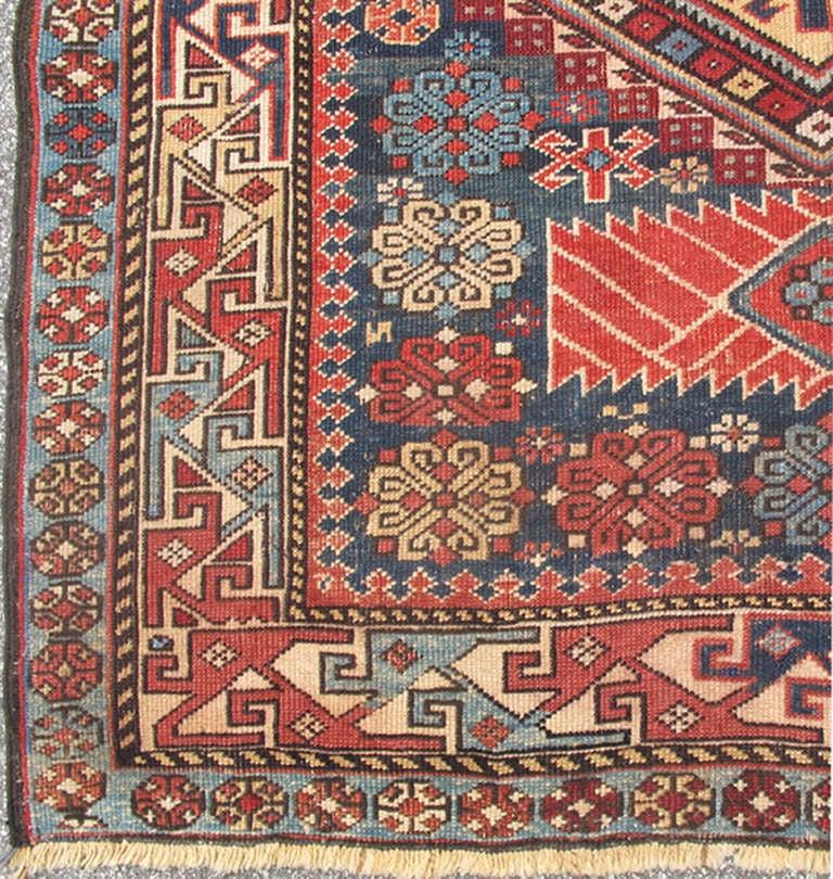 Antique Kazak Rug with Geometric Medallions and Indigo Background 2