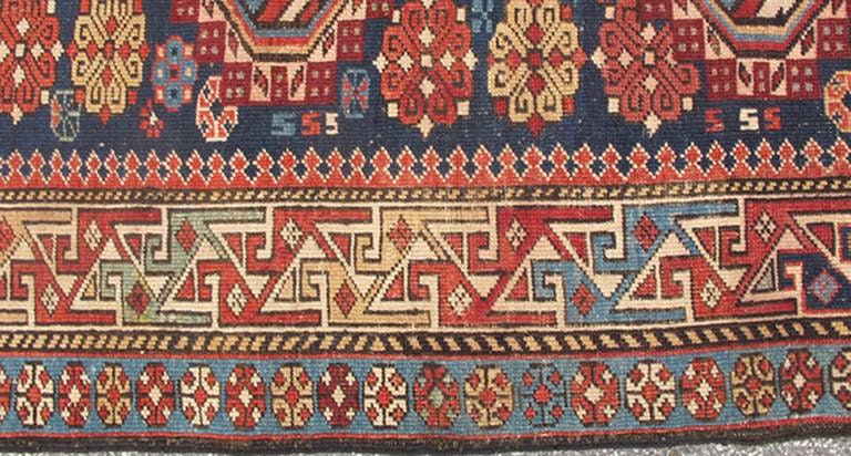 Antique Kazak Rug with Geometric Medallions and Indigo Background 3