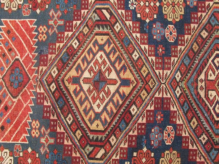 Antique Kazak Rug with Geometric Medallions and Indigo Background 5