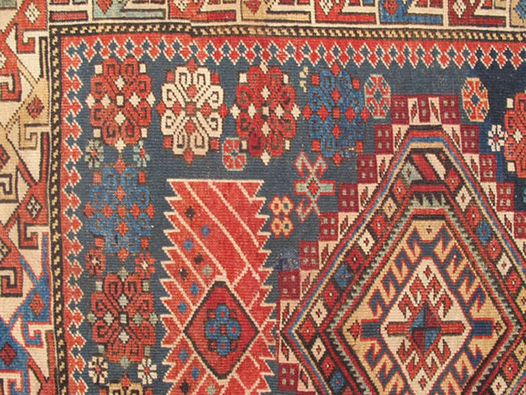 Antique Kazak Rug with Geometric Medallions and Indigo Background 6