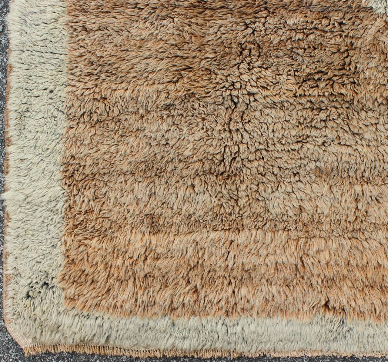 Original antique Tulu rugs are some of the most beautiful textile creations in the entire world. They are soft, usually have vibrant colors and are very shiny. They can be identified by their artistic details and luscious texture. These rugs were