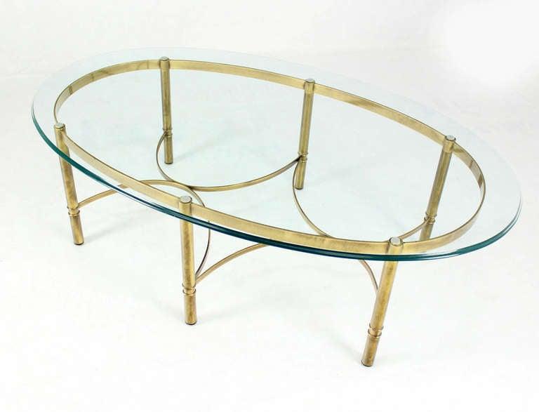 Very nice brass base glass top coffee table.