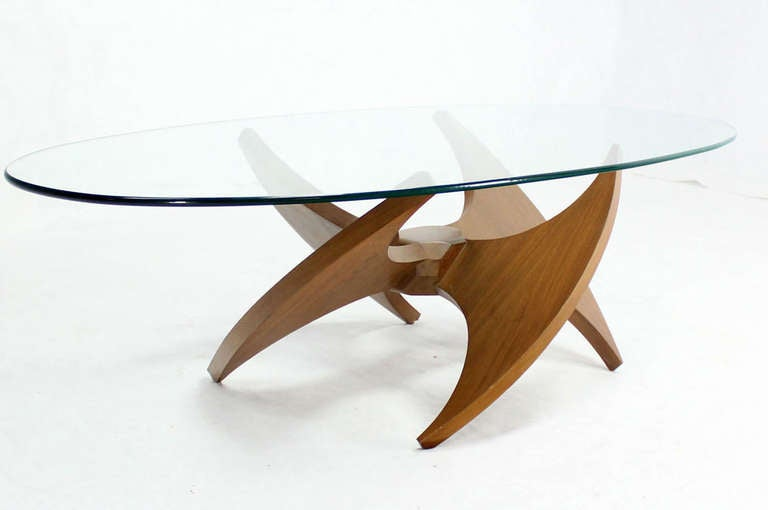 Mid century modern walnut propeller base oval coffee table for Oval glass coffee table